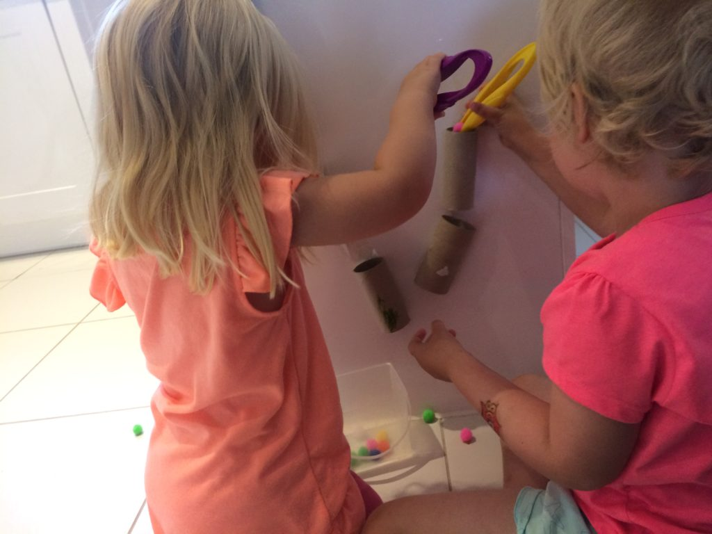 using the finished pom pom marble run